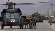 Canadian soldiers load a colleague's body into a helicopter after the attack.